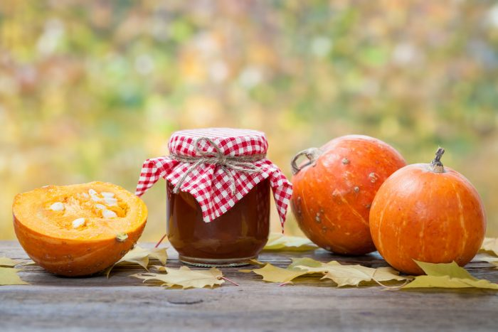 47561153 - jar of pumpkin jam, puree or sauce and small ripe pumpkins on wooden table. autumn still life. selective focus.