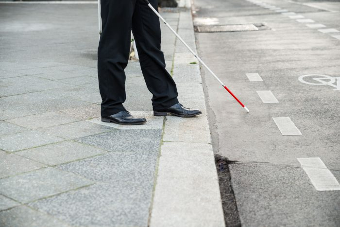 35462225 - low section of a blind person crossing street